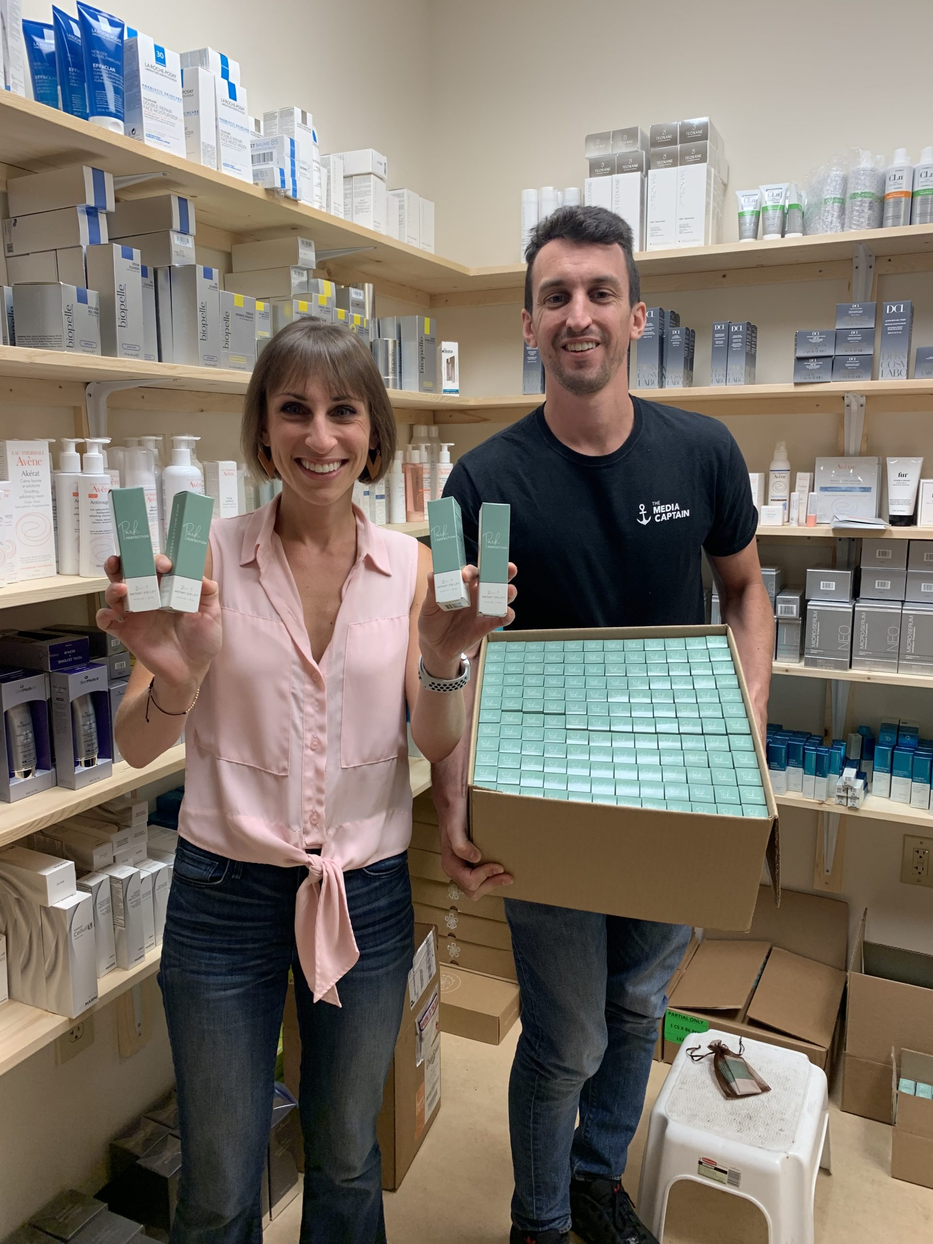 Stefanie & Jason Parks holding up their own skin care line, Park Perfection.